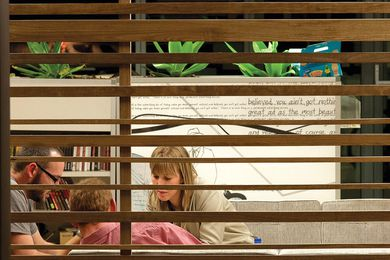 Timber screens provide privacy to lounge areas without blocking light and views.