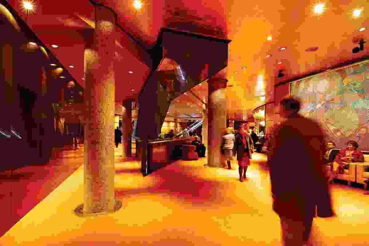 Interiors colours reference John Truscott's original orange carpets.