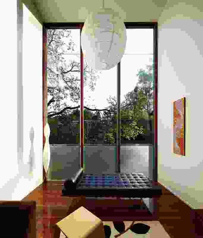 The three-level glazed pod brings the outdoors into the living area.