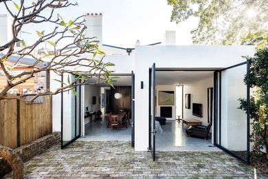 Comprising the kitchen, dining and living areas, the rear extension makes full use of the site. Artwork: Jo Bertini.