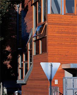 Detail of the timber-clad facade of the new addition to the building.