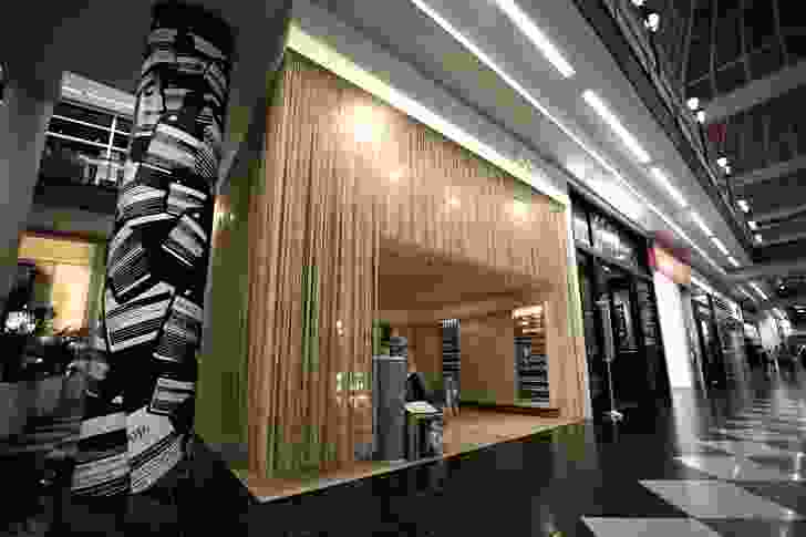 The design of the store makes a statement in the difficult corner space of the shopping centre.