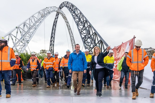 Construction workers cross the bridge with premier Mark McGowan and transport minister Rita Saffioti.