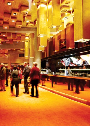 Bars and facilities are pushed to the edge of the foyer space.