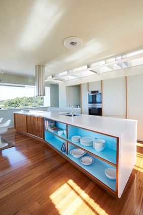 The kitchen is detailed with a beach house sensibility.