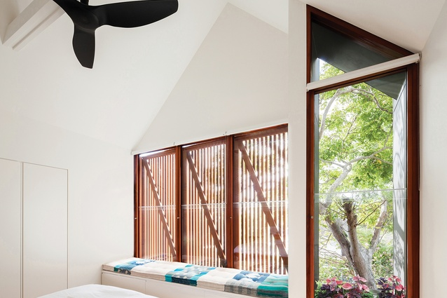 The main bedroom on the upper floor has views into the treetops in the rear garden.