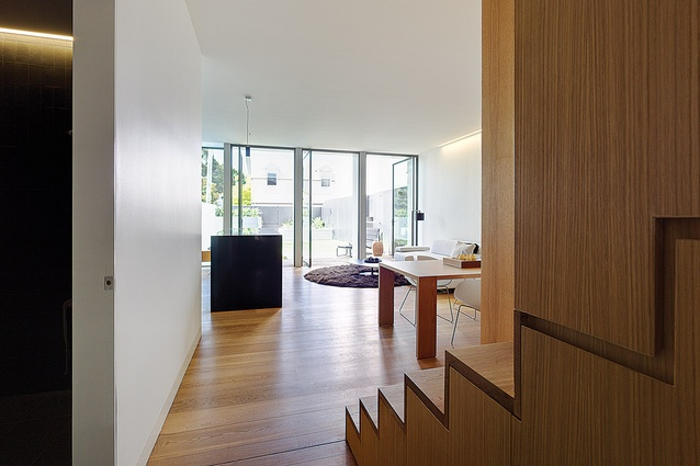 The living spaces are contained at the rear of the property and open out to the backyard.