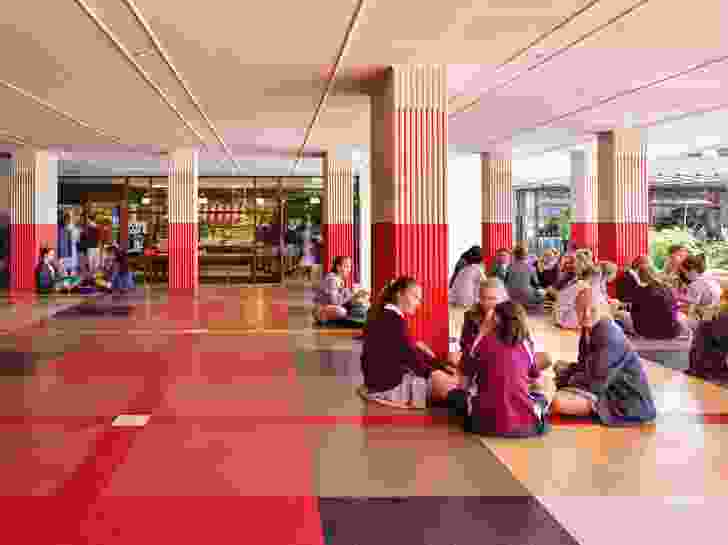 Adjacent to the canteen is a social space for students to eat and talk, designed as a raised platform that is colourfully patterned like a giant picnic rug.