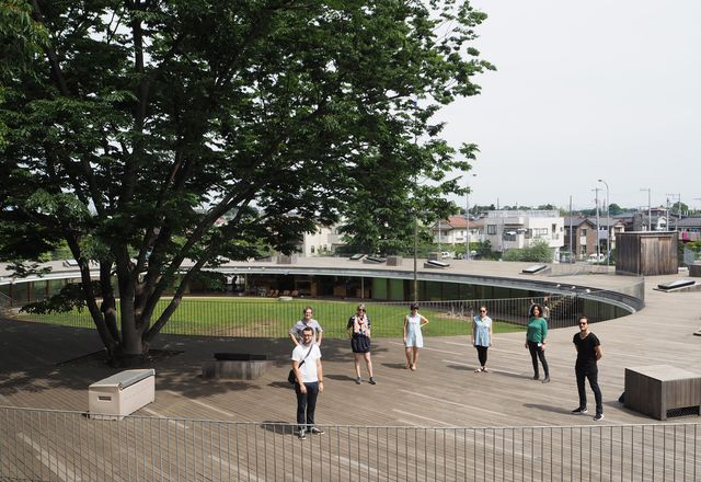 The 2015 Dulux Study Tour winners on the roof of Tezuka Architects' Fuji Kindergarten.